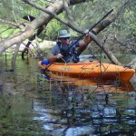 Me kayaking on the Black River
