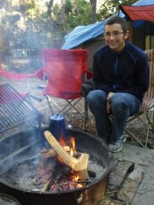 Enjoying a campfire at camp